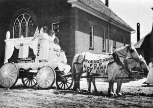 Etta Weatherson, Candace Shaw, Elizabeth Blakeman ride on the WCTU float in 1916 Fourth of July Parade, Columbus, Montana