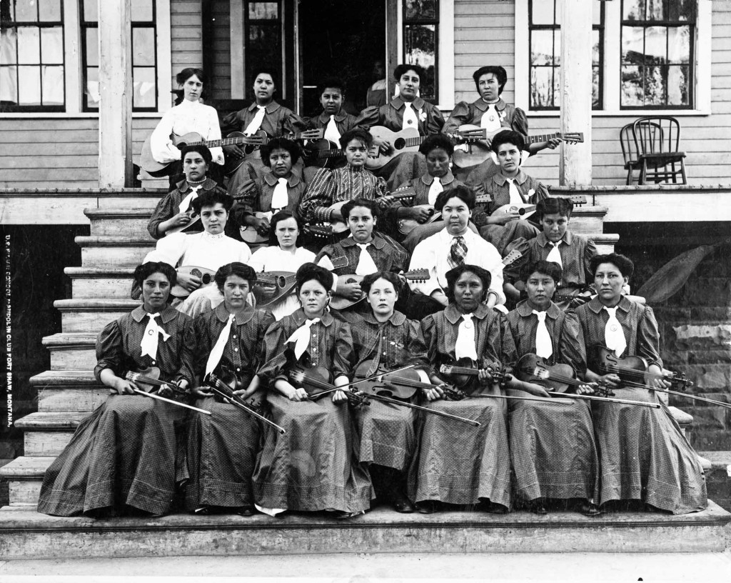 Cultural assimilation was the primary objective of off-reservation boarding schools such as Fort Shaw. Thus, spectators at Fort Shaw's basketball games were also treated to performances of the school's mandolin club, shown here at the school with a variety of stringed instruments.