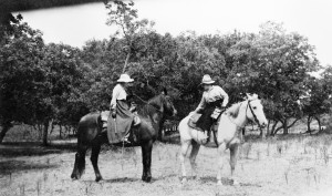 Western author Bertha M. Bower (left) rides side saddle along the Tongue River in 1917, accompanied by Nancy Russell's sister, Jean Ironside. MHS Photo Archives 941-206.