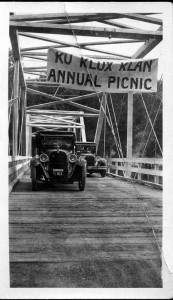 099WHM Western Heritage 86.71.01 a,b Car on south bridge with banner Ku Klux Klan annual meeting