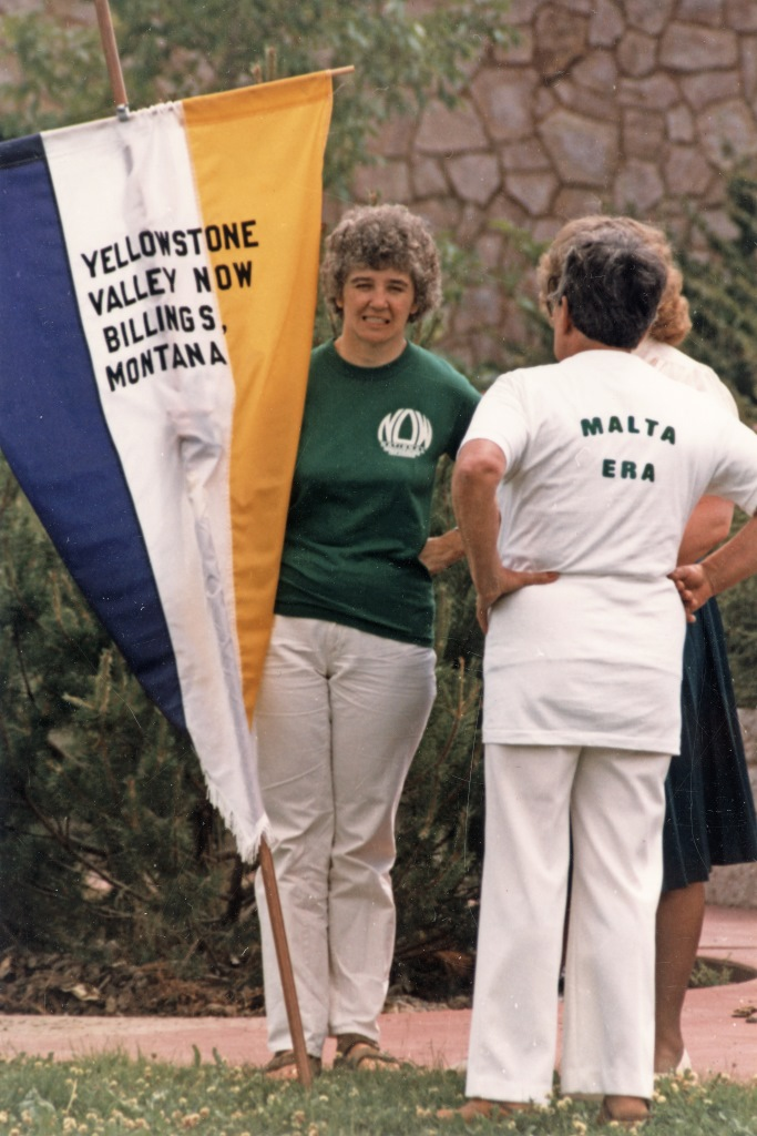 """Yellowstone Valley NOW Dee Adams holding Yellowstone Valley NOW banner and Doris Brander (hometown Malta, Montana) with back to camera. At """"Failure is Impossible"""" celebration in Helena, Montana, to promote passage of the Equal Rights Ammendment. July 1, 1982"""